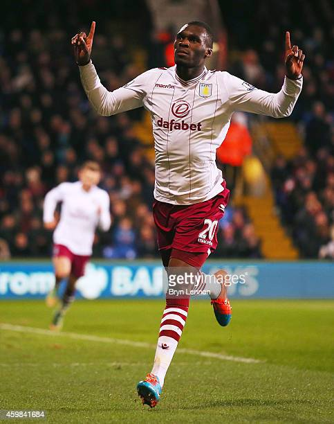 Christian Benteke of Aston Villa celebrates scoring his team's first goal during the Barclays Premier League match between Crystal Palace and Aston...