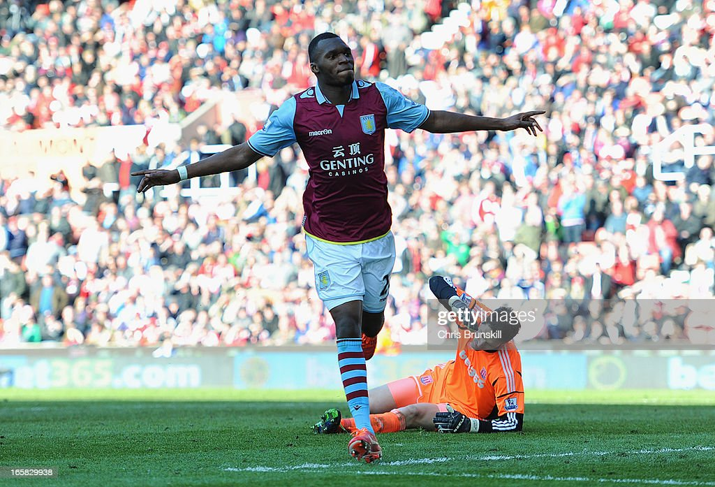 Christian Benteke of Aston Villa celebrates scoring his team's third goal to make the score 1-3 during the Barclays Premier League match between Stoke City and Aston Villa at the Britannia Stadium on April 6, 2013 in Stoke on Trent, England.