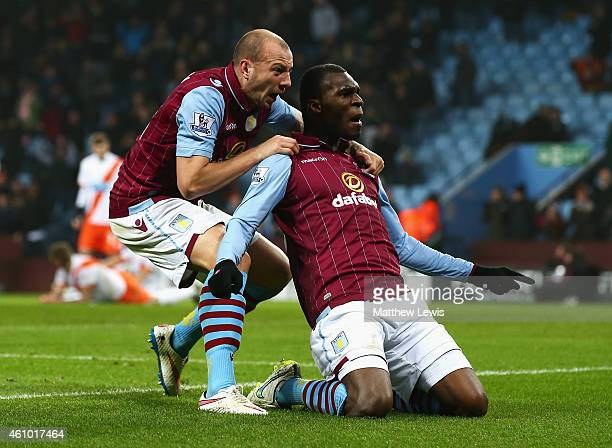 Christian Benteke of Aston Villa celebrates scoring the opening goal with Alan Hutton during the FA Cup Third Round match between Aston Villa and...
