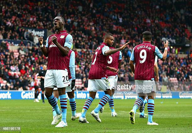 Christian Benteke of Aston Villa celebrates scoring their fourth goal during the Barclays Premier League match between Sunderland and Aston Villa at...