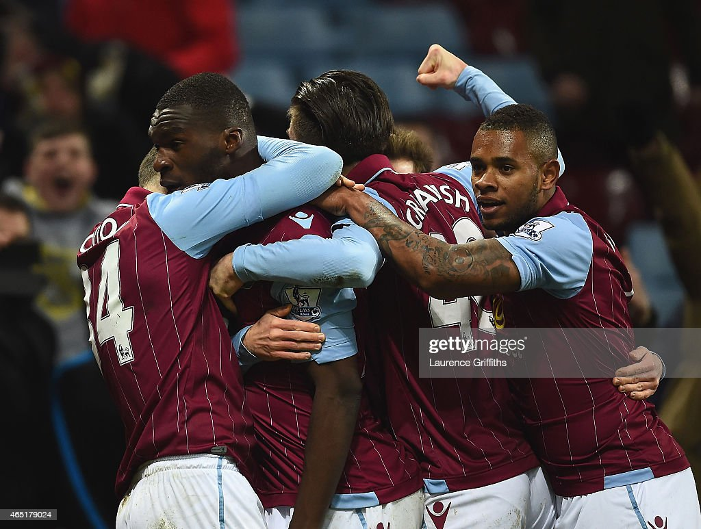 Christian Benteke of Aston Villa celebrates scoring their second goal from the penalty spot with team mates during the Barclays Premier League match between Aston Villa and West Bromwich Albion at Villa Park on March 3, 2015 in Birmingham, England.