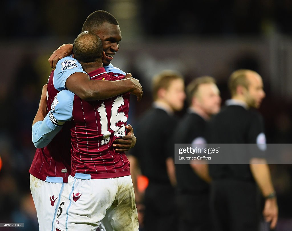 Christian Benteke of Aston Villa celebrates scoring their second goal from the penalty spot with Fabian Delph during the Barclays Premier League match between Aston Villa and West Bromwich Albion at Villa Park on March 3, 2015 in Birmingham, England.