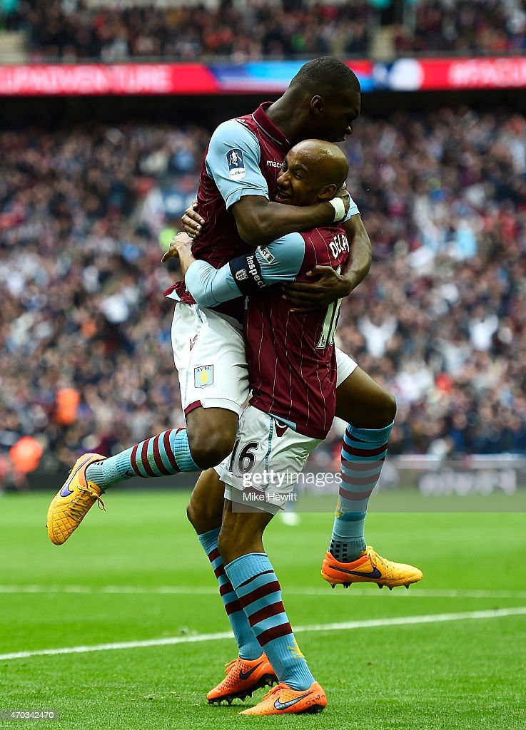 Christian Benteke of Aston Villa (L) celebrates with Fabian Delph of Aston Villa after scoring the second goal during the FA Cup Semi Final between Aston Villa and Liverpool at Wembley Stadium on April 19, 2015 in London, England.