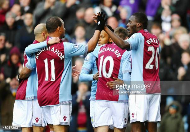 Christian Benteke of Aston Villa celebrates with teammates after scoring the opening goal during the Barclays Premier League match between Aston...