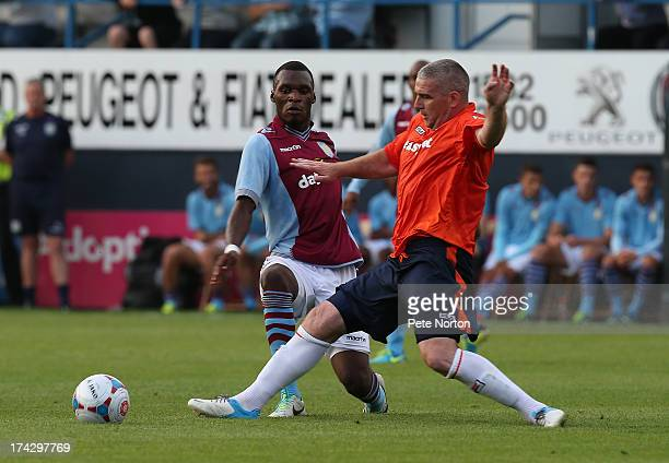 Christian Benteke of Aston Villa contests the ball with Steve McNulty of Luton Town during the Pre Season Friendly match between Luton Town and Aston...