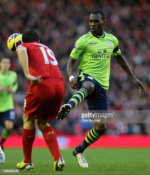 Christian Benteke of Aston Villa in action with Stewart Downing of Liverpool during the Barclays Premier League match between Liverpool and Aston...