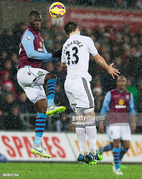 Christian Benteke of Aston Villa is challenged by Federico Fernandez of Swansea City during the Barclays Premier League match between Swansea and...