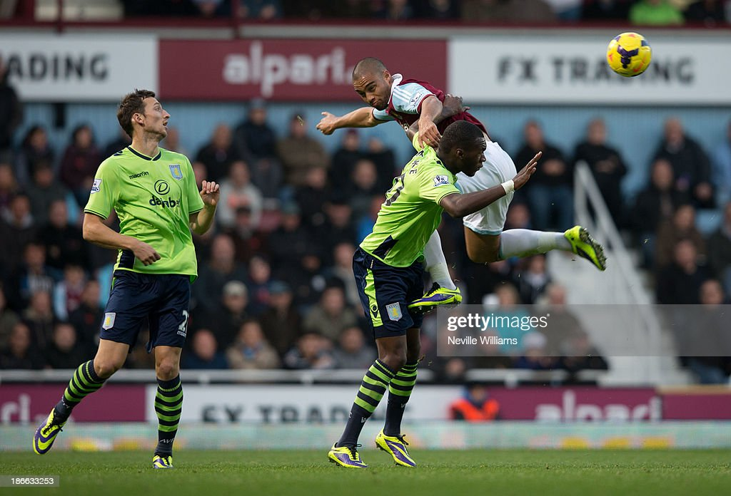 Christian Benteke of Aston Villa is challenged by Winston Reid of West Ham United during the Barclays Premier League match between West Ham United and Aston Villa at the Boleyn Ground on November 02, 2013 in London, England.