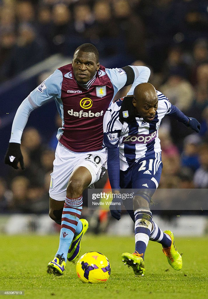 Christian Benteke of Aston Villa is challenged by Youssouf Mulumbu of West Bromwich Albion during the Barclays Premier League match between West Bromwich Albion and Aston Villa at The Hawthorns on November 25, 2013 in West Bromwich, England.