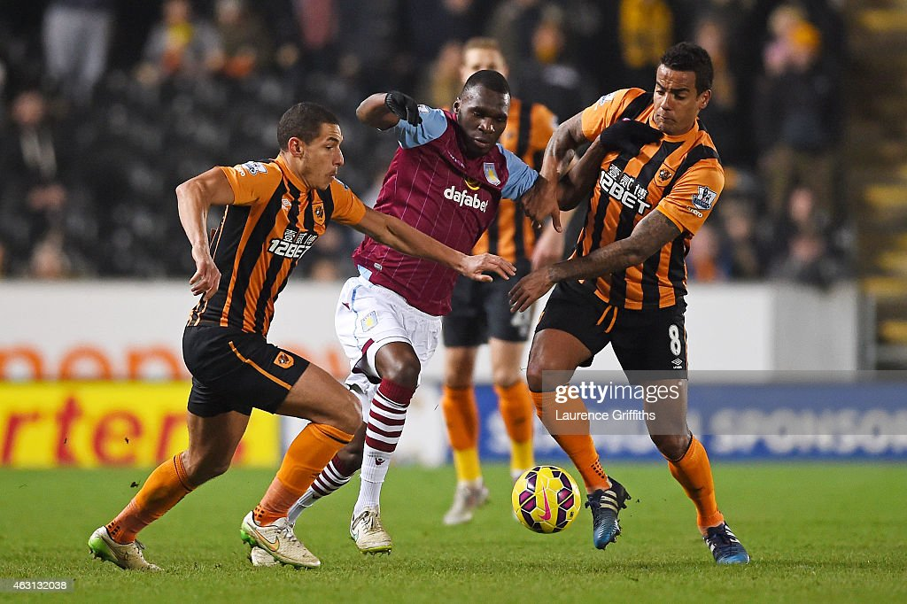 Christian Benteke of Aston Villa is closed down by Jake Livermore of Hull City and Tom Huddlestone of Hull City during the Barclays Premier League match between Hull City and Aston Villa at the KC Stadium on February 10, 2015 in Hull, England.