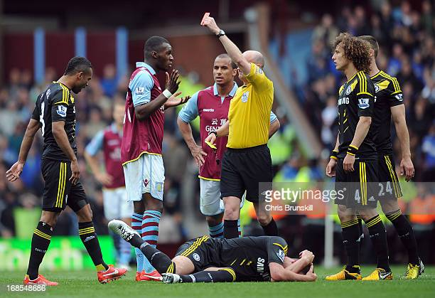 Christian Benteke of Aston Villa reacts as he is shown a red card by referee Lee Mason during the Barclays Premier League match between Aston Villa...