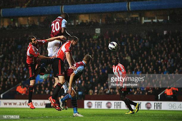 Christian Benteke of Aston Villa rises above the Sunderland defence to score his sides fourth goal during the Barclays Premier League match between...