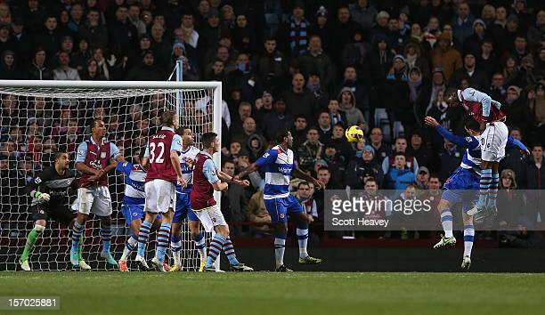 Christian Benteke of Aston Villa rises to score the opening goal during the Barclays Premier league match between Aston Villa and Reading at Villa...
