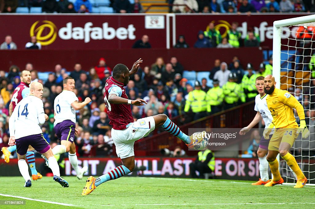 Christian Benteke of Aston Villa scores his team's second goal during the Barclays Premier League match between Aston Villa and Everton at Villa Park on May 2, 2015 in Birmingham, England.