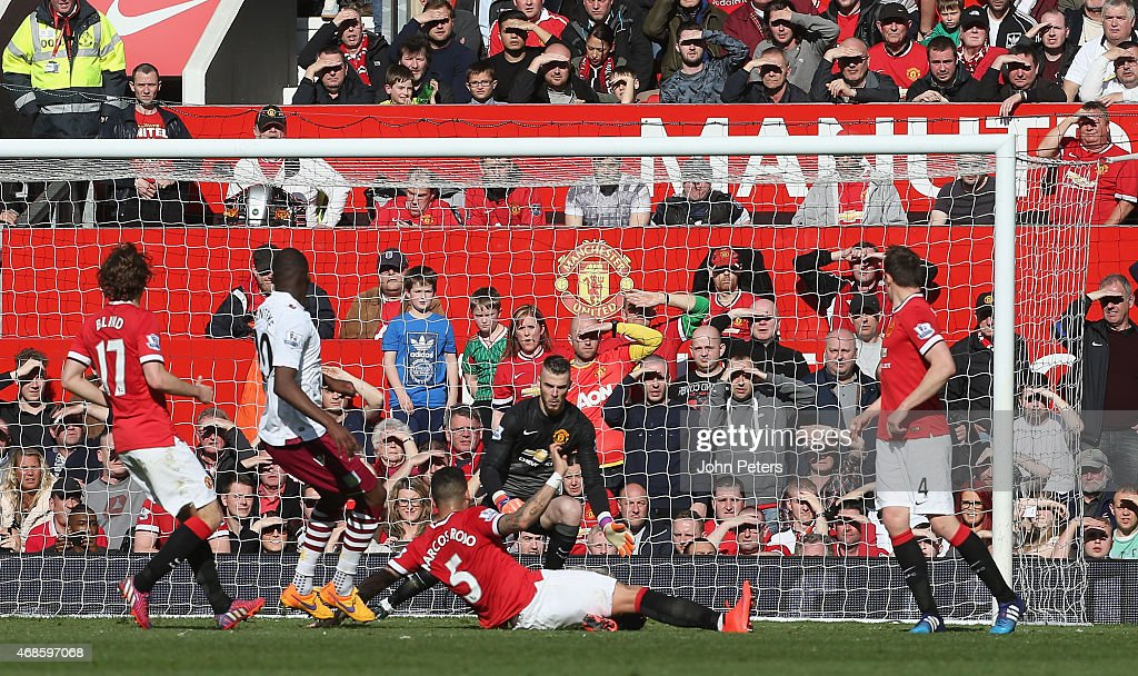 Christian Benteke of Aston Villa scores their first goal during the Barclays Premier League match between Manchester United and Aston Villa at Old Trafford on April 4, 2015 in Manchester, England.