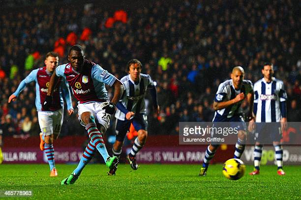 Christian Benteke of Aston Villa scores their fourth goal from the penalty spot during the Barclays Premier League match between Aston Villa and West...