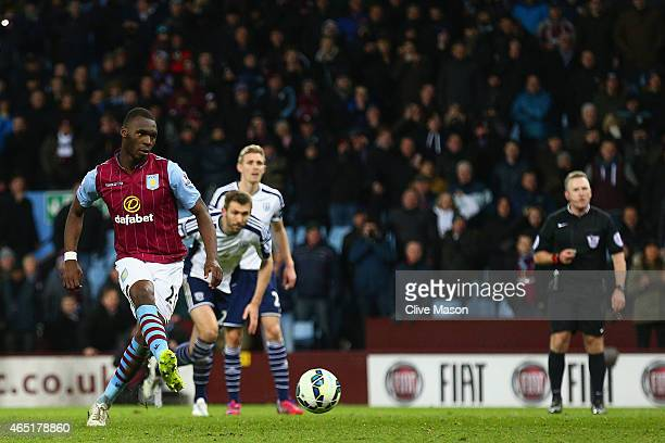 Christian Benteke of Aston Villa scores their second goal from the penalty spot during the Barclays Premier League match between Aston Villa and West...