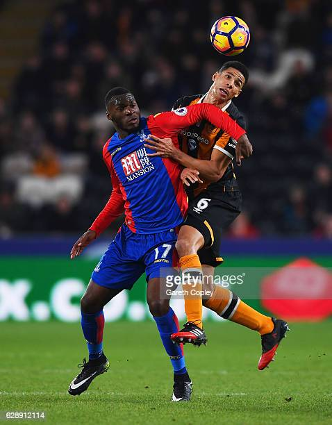 Christian Benteke of Crystal Palace and Curtis Davies of Hull City battle for the ball during the Premier League match between Hull City and Crystal...