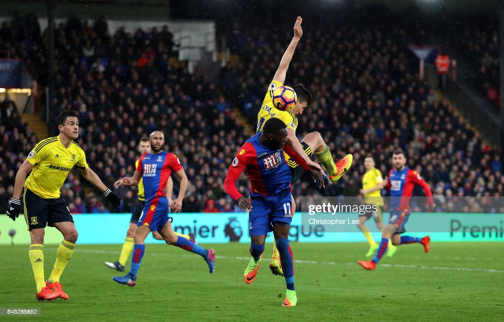 Christian Benteke of Crystal Palace (L) and Daniel Ayala of Middlesbrough (R) battle to win a header during the Premier League match between Crystal Palace and Middlesbrough at Selhurst Park on February 25, 2017 in London, England.