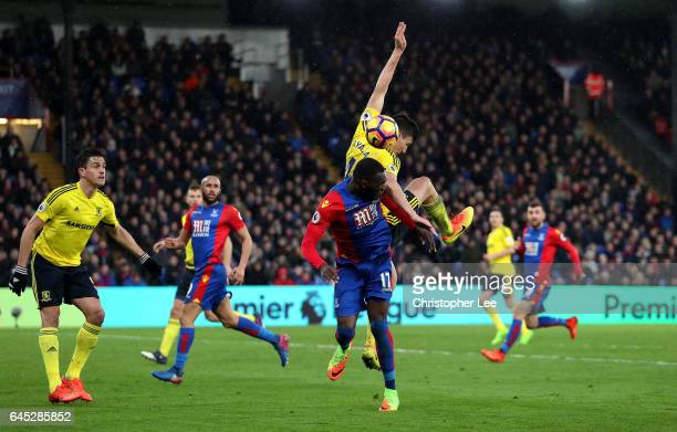 Christian Benteke of Crystal Palace and Daniel Ayala of Middlesbrough battle to win a header during the Premier League match between Crystal Palace...