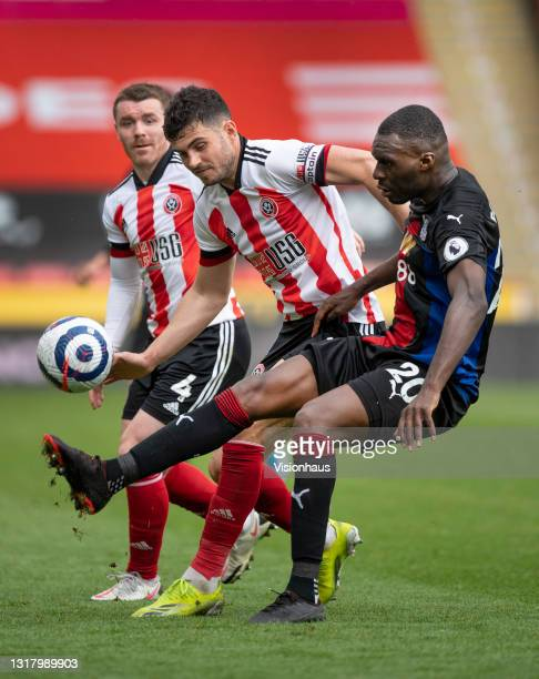 Christian Benteke of Crystal Palace and John Egan of Sheffield United in action during the Premier League match between Sheffield United and Crystal...