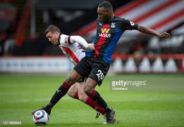 Christian Benteke of Crystal Palace and John Fleck of Sheffield United in action during the Premier League match between Sheffield United and Crystal...