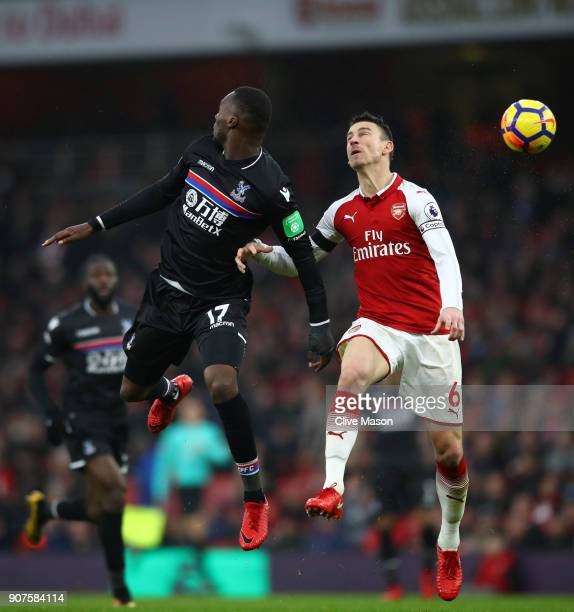Christian Benteke of Crystal Palace and Laurent Koscielny of Arsenal jump for a header during the Premier League match between Arsenal and Crystal...