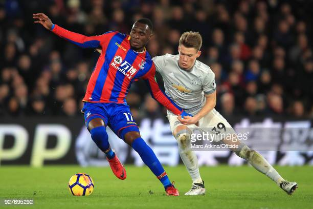 Christian Benteke of Crystal Palace and Scott Mctominay of Man Utd battle for the ball during the Premier League match between Crystal Palace and...