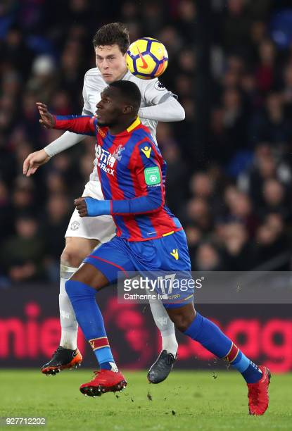 Christian Benteke of Crystal Palace and Victor Lindelof of Manchester United in action during the Premier League match between Crystal Palace and...