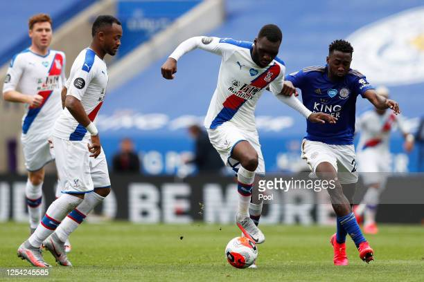 Christian Benteke of Crystal Palace and Wilfred Ndidi of Leicester City battle for the ball during the Premier League match between Leicester City...