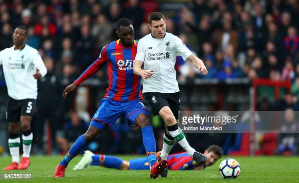 Christian Benteke of Crystal Palace battles for possesion with James Milner of Liverpool during the Premier League match between Crystal Palace and...