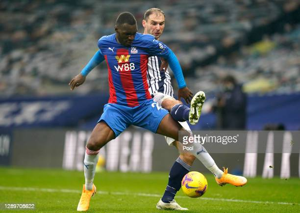Christian Benteke of Crystal Palace battles for possession with Branislav Ivanovic of West Bromwich Albion during the Premier League match between...