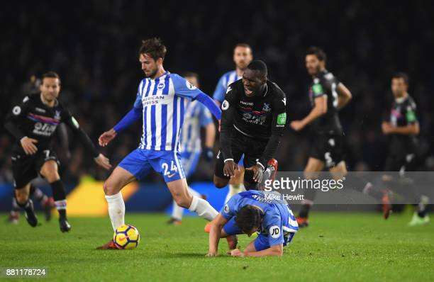 Christian Benteke of Crystal Palace battles with Lewis Dunk and Davy Propper of Brighton and Hove Albion during the Premier League match between...