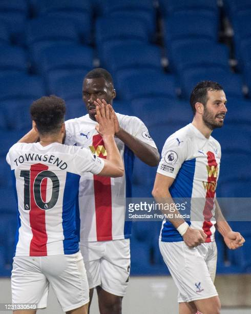 Christian Benteke of Crystal Palace celebrate with his teammates Andros Townsend and Jaïro Riedewald after scoring last minute goal during the...