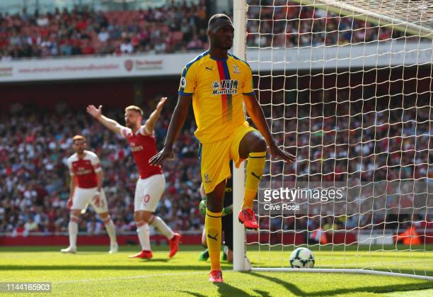 Christian Benteke of Crystal Palace celebrates after scoring his team's first goal during the Premier League match between Arsenal FC and Crystal...