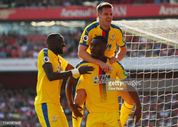 Christian Benteke of Crystal Palace celebrates after scoring his team's first goal with Scott Dann and Cheikhou Kouyate during the Premier League...