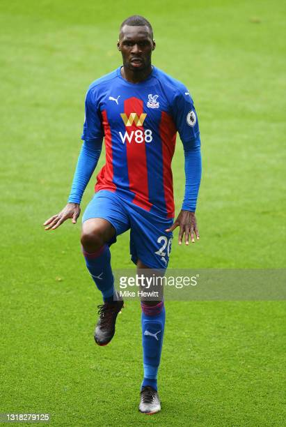 Christian Benteke of Crystal Palace celebrates after scoring their team's first goal during the Premier League match between Crystal Palace and Aston...