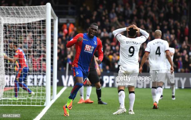 Christian Benteke of Crystal Palace celebrates after Troy Deeney of Watford scores a own goal for Crystal Palace first goal during the Premier League...