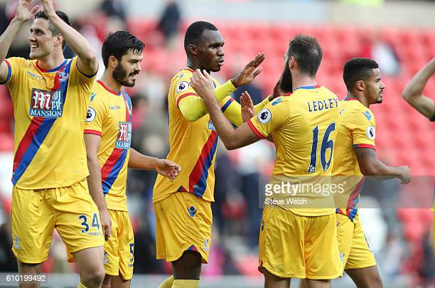 Christian Benteke of Crystal Palace celebrates at the end of the match with team mate Joe Ledley after the Premier League match between Sunderland...