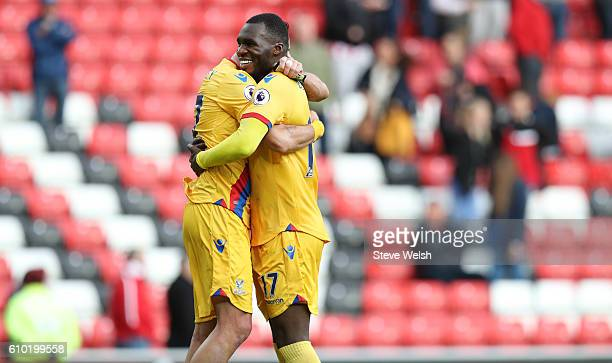 Christian Benteke of Crystal Palace celebrates at the end of the match with team mate Lee Cattermole after the Premier League match between...
