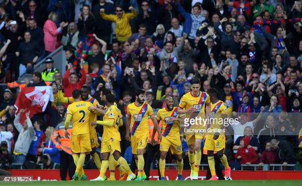 Christian Benteke of Crystal Palace celebrates his side's second goal with his team mates during the Premier League match between Liverpool and...