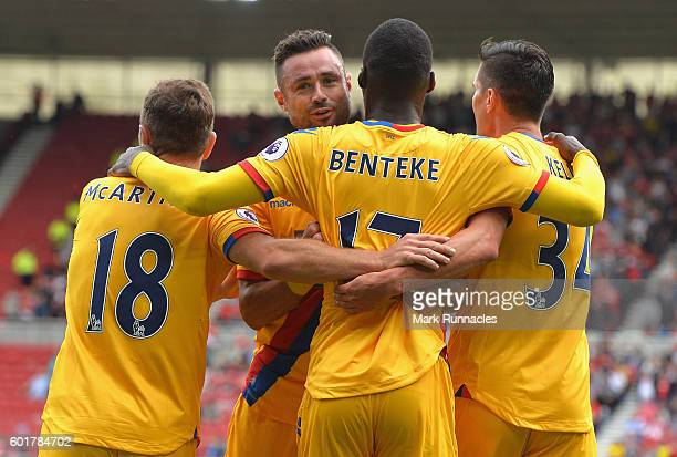 Christian Benteke of Crystal Palace celebrates scoring his sides first goal with his Crystal Palace team mates during the Premier League match...