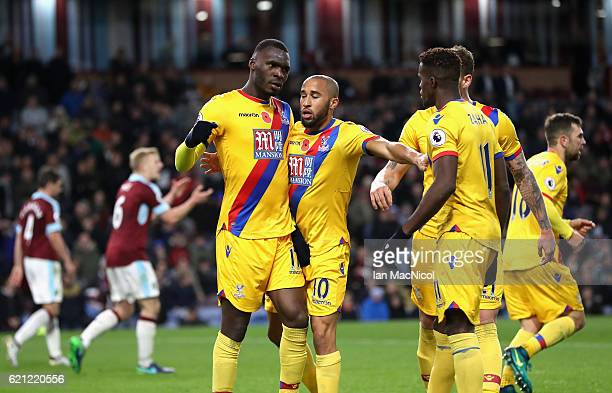 Christian Benteke of Crystal Palace celebrates scoring his sides second goal with Andros Townsend of Crystal Palace and Wilfried Zaha of Crystal...