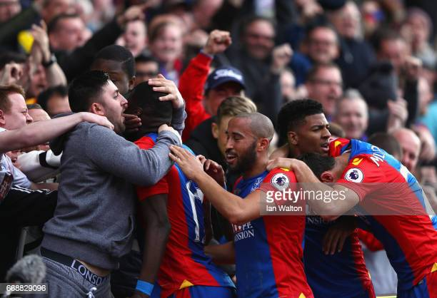 Christian Benteke of Crystal Palace celebrates scoring his sides second goal with his Crystal Palace team mates and a Crystal Palace fan during the...
