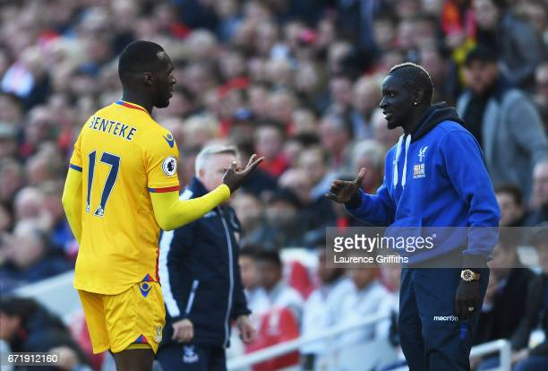 Christian Benteke of Crystal Palace celebrates scoring his side's first goal with his team mate Bakary Sako during the Premier League match between...