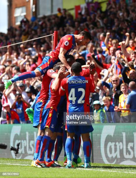 Christian Benteke of Crystal Palace celebrates scoring his sides second goal with his Crystal Palace team mates during the Premier League match...