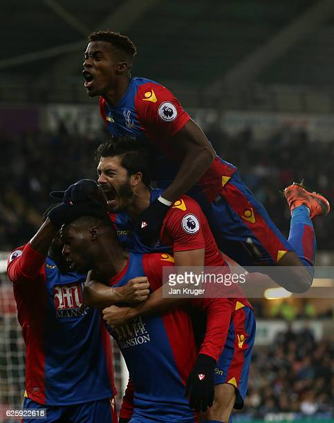 Christian Benteke of Crystal Palace celebrates scoring his team's fourth goal with his team mates during the Premier League match between Swansea...
