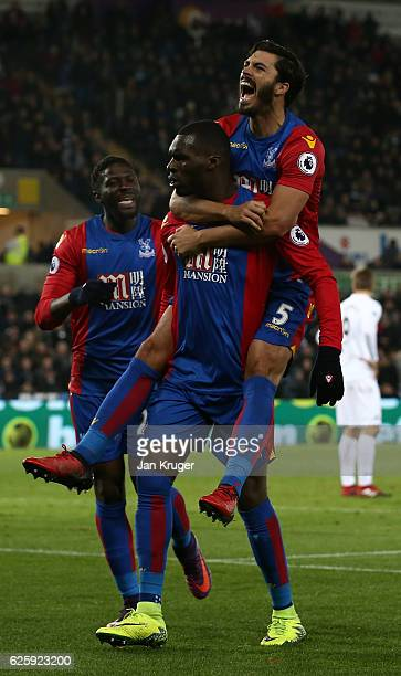 Christian Benteke of Crystal Palace celebrates scoring his team's fourth goal with his team mates James Tomkins during the Premier League match...