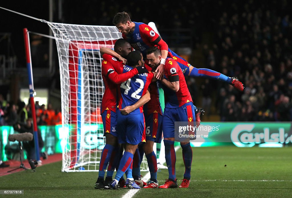 Christian Benteke (1st L) of Crystal Palace celebrates scoring his team's third goal with his team mates during the Premier League match between Crystal Palace and Southampton at Selhurst Park on December 3, 2016 in London, England.
