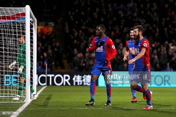 Christian Benteke of Crystal Palace celebrates scoring his team's third goal withi his team mate Joe Ledley during the Premier League match between...